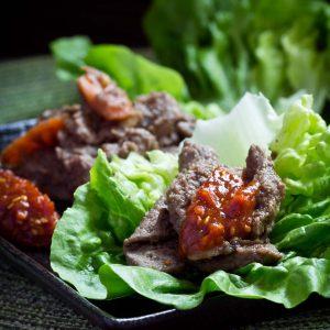 Korean Bulgogi with ssamjang sauce served with fresh lettuce