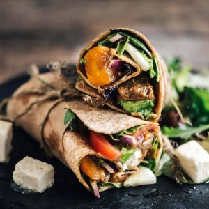 Tortilla wraps sandwiches with ground meat and vegetables salad,selective focus